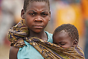 A girl carries a younger child at the Miketo IDP settlement, Katanga province, Democratic Republic of Congo on Sunday February 19, 2012.