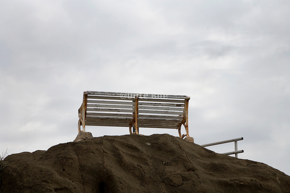 bench placed on top of a hill