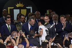 May 25, 2019 - Seville, Spain - Daniel Parejo of Valencia shakes hands with King Felipe VI of Spain before lifting the trophy after winning with his team the during the Spanish Copa del Rey match between Barcelona and Valencia at Estadio Benito Villamarin on May 25, 2019 in Seville. (Credit Image: © Jose Breton/NurPhoto via ZUMA Press)