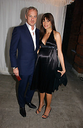 ANTON & LISA BILTON at a party to celebrate the opening of Roger Vivier in London held at The Orangery, Kensington Palace, London on 10th May 2006.<br />