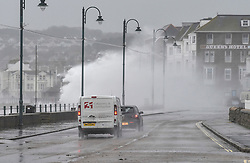 © Licensed to London News Pictures.03/02/2017. Cars are showered in waves battering the coastline at  Penzance in Cornwall as the unofficially named storm DORIS hits the UK coast. Photo credit : Mark Hemsworth/LNP