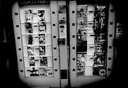 Vending machine for porn magazines which has reflective glass so that it is not possible during daylight to see the sexually explicit covers of porn magazines but when illuminated from behind the glass at night, the covers are visible to passersby, Kabuki-cho red light district, Tokyo, Japan.