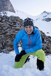 Portrait of male skier on snow covered mountain, Tyrol, Austria