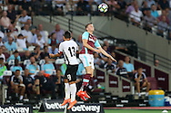 Sam Byram of West Ham United competes for a header with Junior Morais, the Astra Giurgiu captain. UEFA Europa league, 1st play off round match, 2nd leg, West Ham Utd v Astra Giurgiu at the London Stadium, Queen Elizabeth Olympic Park in London on Thursday 25th August 2016.<br /> pic by John Patrick Fletcher, Andrew Orchard sports photography.