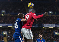 Football - 2017 / 2018 Premier League - Chelsea vs Manchester United<br /> <br /> Romelu Lukaku (Manchester United) heads the ball ahead of Cesar Azpilicueta (Chelsea FC) at Stamford Bridge <br /> <br /> COLORSPORT/DANIEL BEARHAM