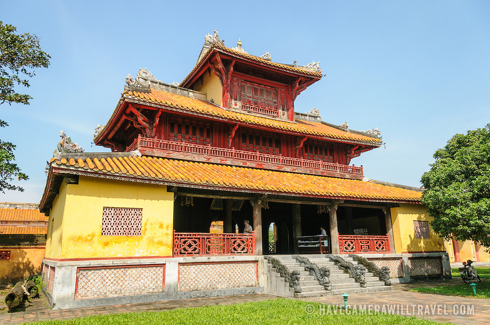 A brightly colored restored building in the grounds of the Imperial City in Hue, Vietnam. A self-enclosed and fortified palace, the complex includes the Purple Forbidden City, which was the inner sanctum of the imperial household, as well as temples, courtyards, gardens, and other buildings. Much of the Imperial City was damaged or destroyed during the Vietnam War. It is now designated as a UNESCO World Heritage site.