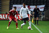 Tom Ince of England holds off Declan John of Wales. UEFA 2015 European U21 championship, group one qualifier , Wales u21 v England u21 at the Liberty Stadium in Swansea, South Wales on Monday 19th May 2014. <br /> pic by Andrew Orchard, Andrew Orchard sports photography.
