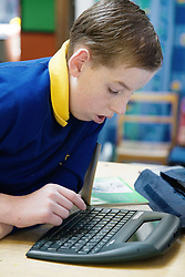Child with brain damage in maths lesson,