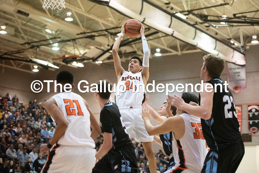 Gallup's Quinn Atazhoon (24) grabs a free throw against  Sandia Prep Friday night at the Gallup Invitational boys basketball tournament at Gallup High School. Gallup beat Sandia Prep 61-60.