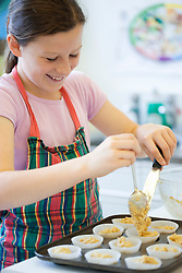 Young girl in cookery class baking