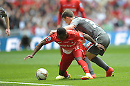 Leyton Orient's Moses Odubajo is challenged  by Rotherham United's Richard Smallwood Skybet football league one play off final match , Leyton Orient  v Rotherham Utd at Wembley Stadium in  London on Sunday 25th May 2014.<br /> pic by John Patrick Fletcher, Andrew Orchard sports photography.