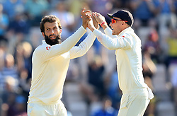 England's Moeen Ali and Joe Root celebrate the wicket of India's Mohammed Shami during day four of the fourth test at the AGEAS Bowl, Southampton.