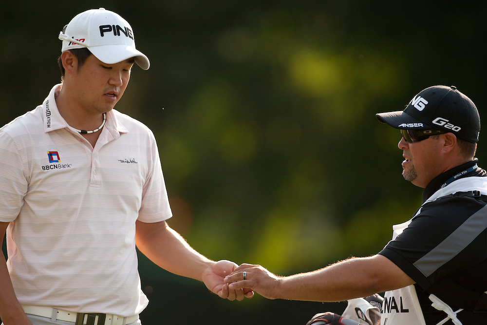 BETHESDA, MD - JUNE 28: John Huh and caddie Zeke Salas during the first round of the 2012 AT&T National at Congressional Country Club in in Bethesda, Maryland on June 28, 2012. (Photograph ©2012 Darren Carroll) *** Local Caption *** John Huh,Zeke Salas