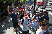 Hundreds of enthusiastic gamers descend with their mobile devices on central London to gather for the first mass Pokemon GO Lure Party in the UK since the game was launched on July 23rd 2016 in London, United Kingdom. Pokémon GO is a free-to-play location-based augmented reality mobile game developed by Niantic for iOS and Android devices. It was released in most regions of the world in July 2016. Making use of GPS and the camera of compatible devices, the game allows players to capture, battle, and train virtual creatures, called Pokémon, who appear on device screens as though in the real world.