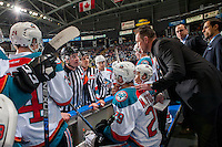 KELOWNA, CANADA - FEBRUARY 10: Kelowna Rockets' head coach Jason Smith stands on the bench and speaks to referee Ward Pateman and linesman Dustin Minty against the Vancouver Giants on February 10, 2017 at Prospera Place in Kelowna, British Columbia, Canada.  (Photo by Marissa Baecker/Shoot the Breeze)  *** Local Caption ***