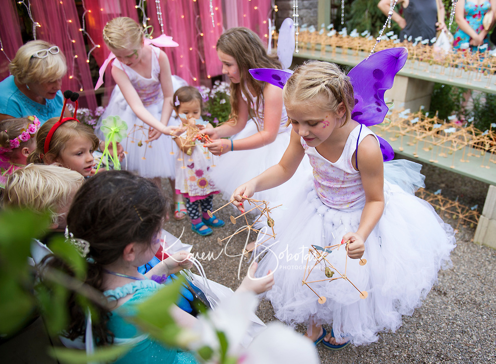 """""""Glimmer"""", """"Shimmer"""" and """"Shine"""" hand out gazebos to catch magic to visitors at Cackleberries Garden Center's Fairy Night Wednesday evening.  (Karen Bobotas/for the Laconia Daily Sun)"""