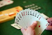 Nederland, Wijchen, 22-9-2013Een vrouw houdt een waaier kaarten in haar hand. Ze speelt bridge bij een bridgeclub.Foto: Flip Franssen/Hollandse Hoogte