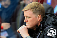 Bournemouth Manager Eddie Howe looks on from the dugout.<br /> Barclays Premier League match, Aston Villa v AFC Bournemouth at Villa Park in Birmingham, The Midlands on Saturday 09th April 2016.<br /> Pic by Ian Smith, Andrew Orchard Sports Photography.