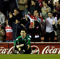 Photo: Jed Wee.<br /> Middlesbrough v Nuneaton Borough. The FA Cup. 17/01/2006.<br /> <br /> Nuneaton goalkeeper Darren Acton sits shellshocked after conceding his fourth goal.