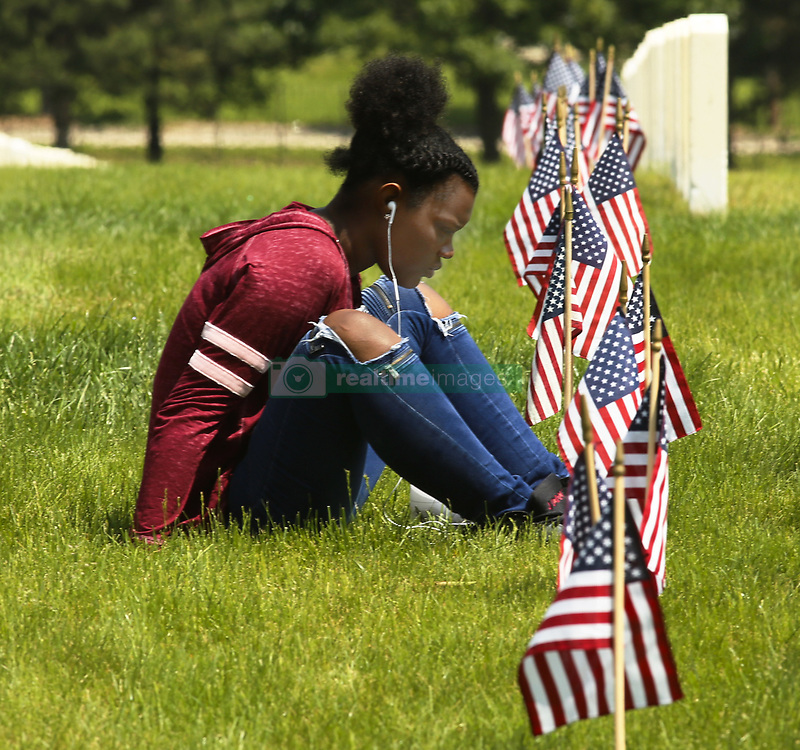 May 27, 2019 - Dayton, Ohio, USA - Gloria Callahan sits at her  grandfather Barry L  E  Cox Grave   who was in the Air Force and pass was in 1987. On Memorial Day at the Dayton National Cemetery in Dayton,Ohio on May 27,2019. (Credit Image: © Ernest Coleman/ZUMA Wire)