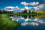 Clouds reflecting on Little Molas lake in the Colorado Rockies.