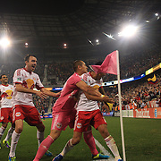 Tim Cahill, New York Red Bulls, hugged by goalkeeper team mate Luis Robles, celebrates with his trademark corner flag punch after his 97th minute  header leveled the scores at 2-2 during the New York Red Bulls V New England Revolution, Major League Soccer regular season match at Red Bull Arena, Harrison, New Jersey. USA. 5th October 2013. Photo Tim Clayton
