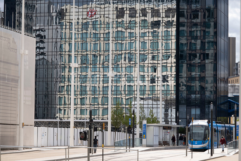 New glass buildings and trams as part of the redevelopment of Paradise as the Coronavirus lockdown continues, the city centre is still very quiet on 28th July 2020 in Birmingham, United Kingdom. Paradise, formerly named Paradise Circus, is the name given to an area of approximately 7 hectares in Birmingham city centre between Chamberlain and Centenary Squares. The area has been part of the civic centre of Birmingham since the 19th century. From 2015 Argent Group will redevelop the area into new mixed use buildings and public squares.