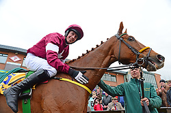 Road To Respect with winning jockey Bryan Cooper after the Ryanair Gold Cup Novice Chase during the Easter Festival at Fairyhouse Racecourse, Co. Meath, Ireland.