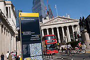 In the week that many more Londoners returned to their office workplaces after the Covid pandemic, a number 26 London bus destined for Waterloo passes Royal Exchange right and the Bank of England left on Threadneedle Street in the City of London, the capitals financial district, on 8th September 2021, in London, England.