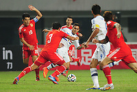 Zheng Zhi, left, and Cai Huikang, second left, of China challenge Derlis Gonzalez of Paraguay, center, during a friendly football match in Changsha city, central China's Hunan province, 14 October 2014.<br /> <br /> Paraguay's dismal run of form continued as they suffered a 2-1 friendly defeat to China on Tuesday (14 October 2014). The South American nation, who came into the game having won two of their previous 13 fixtures, fell short in their bid to pull off a late comeback at Changsha's Helong Stadium. In contrast to their opponents, China have now lost just two of their last 16 matches as they continue to build towards next year's AFC Asian Cup in Australia.