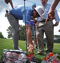 May 4, 2019 - Charlotte, NC, USA - Joel Dahmen is directed to his ball's lie in the fold of Carol Parsons' umbrella off the 5th green at Quail Hollow Club in Charlotte, N.C., during third-round action of the Wells Fargo Championship on Saturday, May 4, 2019. (Credit Image: © TNS via ZUMA Wire)