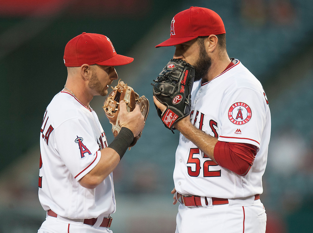 Angels starting pitcher Matt Shoemaker chats with Johnny Giavotella on the mound during a four run second inning for the Cardinals Wednesday night at Angel Stadium.<br /> <br /> ///ADDITIONAL INFO:   <br /> <br /> angels.0512.kjs  ---  Photo by KEVIN SULLIVAN / Orange County Register  --  5/11/16<br /> <br /> The Los Angeles Angels take on the St. Louis Cardinals at Angel Stadium Wednesday.<br /> <br />  5/11/16