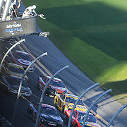 Denny Hamlin (14) and Martin Truex Jr. race to the finish line on the final lap of the 58th Annual NASCAR Daytona 500 auto race at Daytona International Speedway on Sunday, February 21, 2016 in Daytona Beach, Florida.  Hamlin won the race. (Alex Menendez via AP)