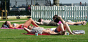 © Licensed to London News Pictures. 25/07/2012. London, UK . People sunbathe as temperatures reach 30 degrees at Greenwhich Pier in London today 25 July 2012. Photo credit : Stephen Simpson/LNP