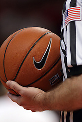 29 November 2014:  Referee holds basketball during an NCAA men's basketball game between the Youngstown State Penguins and the Illinois State Redbirds  in Redbird Arena, Normal IL.
