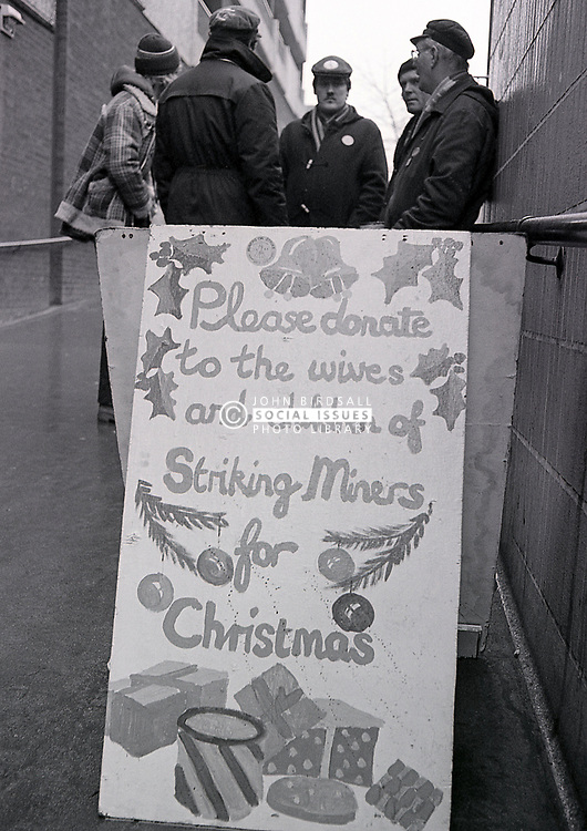 Striking miners collecting in Nottingham town centre just before Christmas, UK December 1984