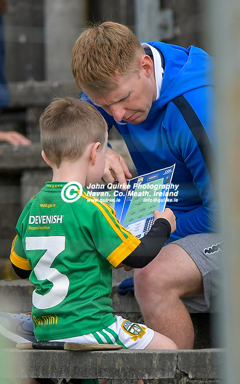 Young Meath supporter goes through the lineout in the programme,  during the Meath v Kerry,  Joe McDonagh Cup match at Pairc Tailteann, Navan.<br /> <br /> Photo: GERRY SHANAHAN-WWW.QUIRKE.IE<br /> <br /> 10-07-2021