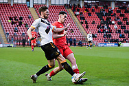 Jamie Procor of Newport County battles for possession with Leyton Orient's Conor Wilkinson(9) during the EFL Sky Bet League 2 match between Leyton Orient and Newport County at the Breyer Group Stadium, London, England on 12 December 2020.