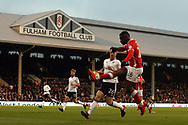 Mamadou Thiam of Barnsley (L) attempts a cross into the box. EFL Skybet championship match, Fulham v Barnsley at Craven Cottage in London on Saturday 23rd December 2017<br /> pic by Steffan Bowen, Andrew Orchard sports photography.