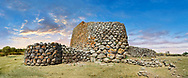 Picture and image of the prehistoric triangular shaped magalith ruins of Nuraghe Losa, archaeological site, Bronze age (14 -9 th century BC),  Abbasanta, Southern Sardinia.