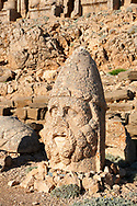 Statue head of Herekles in front of the stone pyramid 62 BC Royal Tomb of King Antiochus I Theos of Commagene, east Terrace, Mount Nemrut or Nemrud Dagi summit, near Adıyaman, Turkey .<br /> <br /> If you prefer to buy from our ALAMY PHOTO LIBRARY  Collection visit : https://www.alamy.com/portfolio/paul-williams-funkystock/nemrutdagiancientstatues-turkey.html<br /> <br /> Visit our CLASSICAL WORLD HISTORIC SITES PHOTO COLLECTIONS for more photos to download or buy as wall art prints https://funkystock.photoshelter.com/gallery-collection/Classical-Era-Historic-Sites-Archaeological-Sites-Pictures-Images/C0000g4bSGiDL9rw