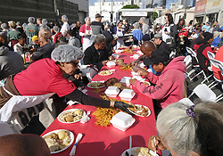 November 22, 2018 - Los Angeles, California, U.S - Volunteers serve Thanksgiving meals to the needy in Los Angeles. Thousands of Skid Row residents and homeless people from downtown and beyond were served turkey dinners during the LA Mission's annual holiday feast. (Credit Image: © Ringo Chiu/ZUMA Wire)