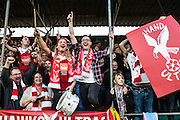 Whitehawk fans celebrate during the The FA Cup match between Whitehawk FC and Lincoln City at the Enclosed Ground, Whitehawk, United Kingdom on 8 November 2015. Photo by Bennett Dean.