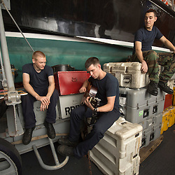 USS John C Stennis CVN-74 Aircraft Carrier.Pic Shows Hangar Personnel relax with a guitar