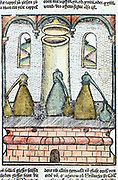Distillation 1500.  Three alembics stand on top of furnace. The distillate condenses in caps on top of vessels and flows down into collecting bottles. The pillar in the centre of the furnace is for refuelling.  From ' Liber de arte distillandi de simplicibus' by Hieronmus Braunschweig. (Strasbourg, 1500).