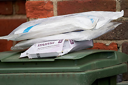 © Licensed to London News Pictures. 07/04/2021. WENDOVER, UK.  Items left at the scene on Aylesbury Road following a murder at around 5:30pm yesterday (Tue). A 77 year old man died after sustaining serious injuries inside a house. A 36 year old man has been arrested.  Photo credit: Cliff Hide/LNP
