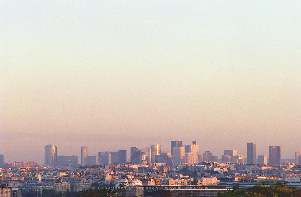 Modern skyskraper office buildings at La Defense complex. Skyline in evening sunlight. Paris, France.