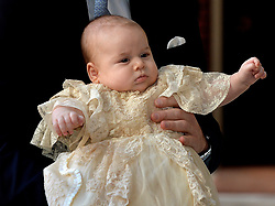 ALTERNATE CROP The Duke of Cambridge arrives, holding his son Prince George, at Chapel Royal in St James's Palace, ahead of the christening of the three month-old Prince George of Cambridge by the Archbishop of Canterbury in central London.