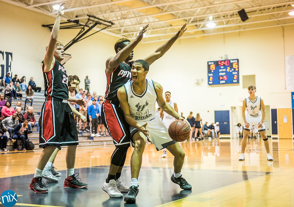 Hickory Ridge's Julian Carlton (24) looks to shoot against Patton during the first round of the NCHSAA playoffs. Hickory Ridge won the game 59-50.