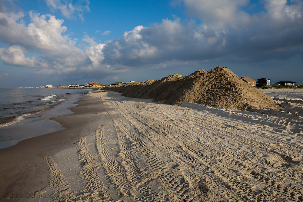 Sand burms built by the National Guard on Dauphin Island, Alabama built to protect the islands marshlan from the BP oil spill. Oil has washed up on beach on Dauphin Island.